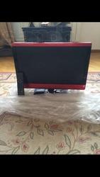 Телевизор Technika красного цвета с встроенным Dvd